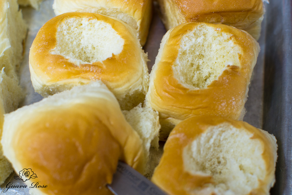 Cutting out centers of Hawaiian sweet rolls