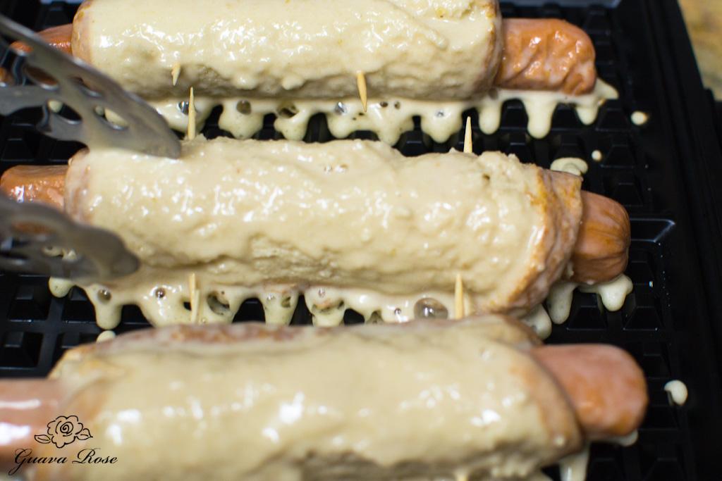Waffle dogs placed on waffle iron
