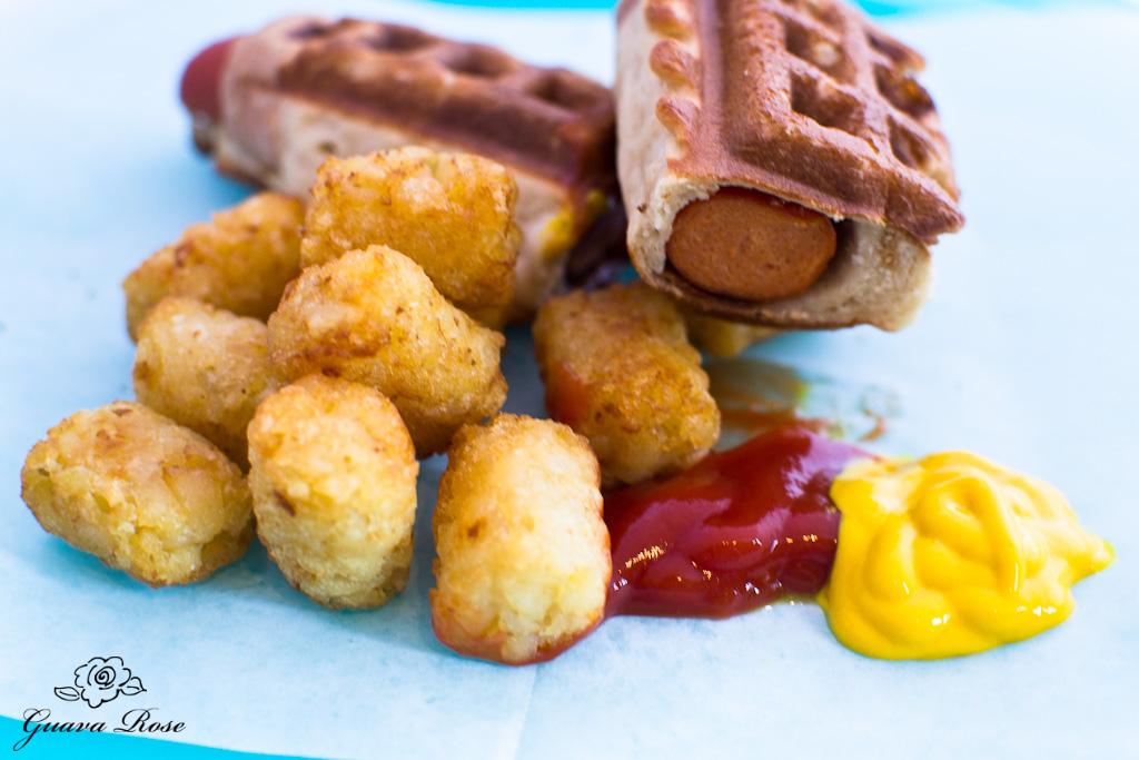 Cut waffle dog with tater tots, ketchup, mustard