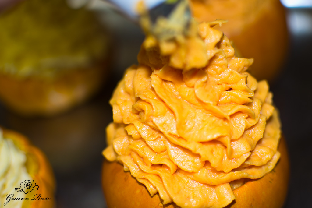 Piping maple vanilla sweet potatoes into mini pumpkin