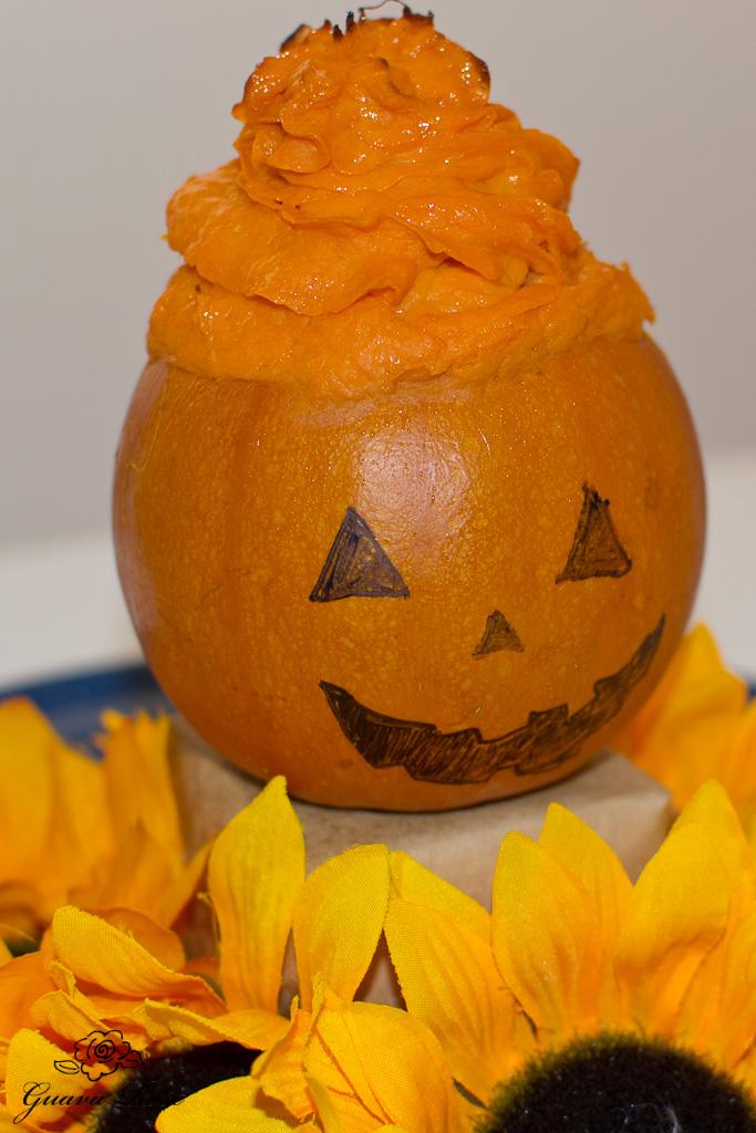 Maple vanilla sweet potatoes in mini pumpkins with Jack-o lantern face
