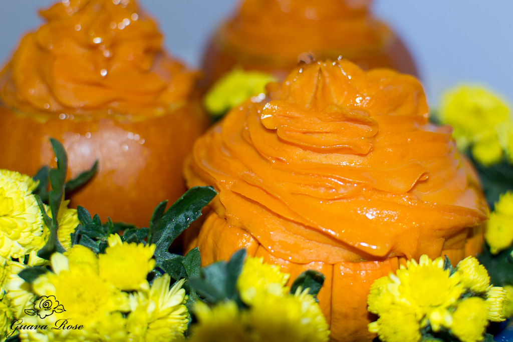 Maple vanilla sweet potatoes in mini pumpkins with mums