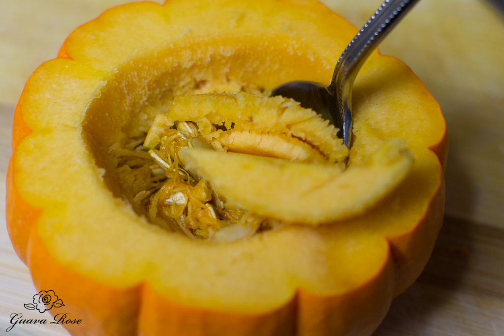 Scooping seeds out of mini pumpkin