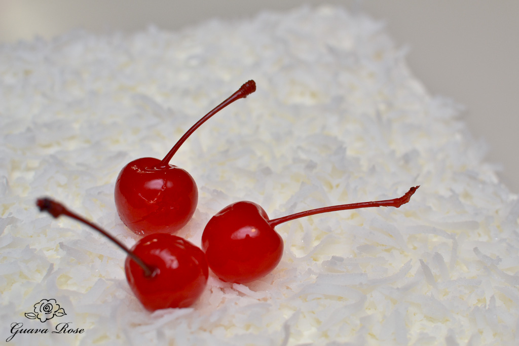 close up of 3 cherries on top of haupia chiffon torte