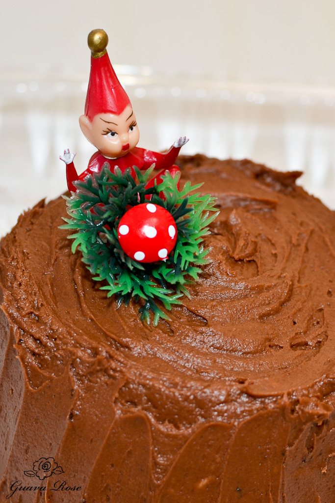 Buche de Noel log end with red elf and mushroom