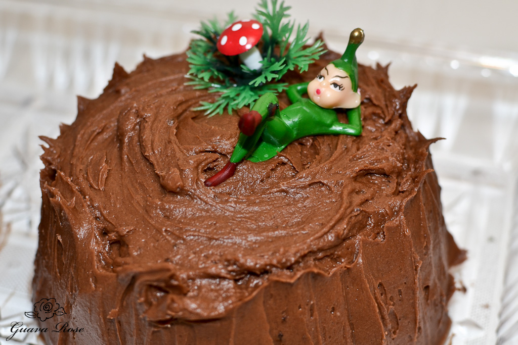 buche de Noel log end with green elf and mushroom