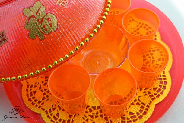 Chinese candy holder, with 3 oz orange plastic cups