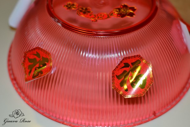 decorations initially glued onto chinese candy holder