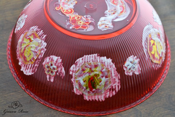 Gluing over decorations on chinese candy holder