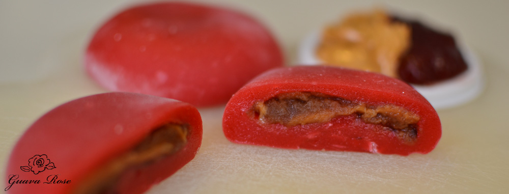 Strawberry jam peanut butter mochi, cut in half