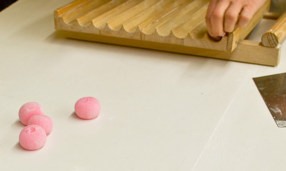 Pink dango balls on table