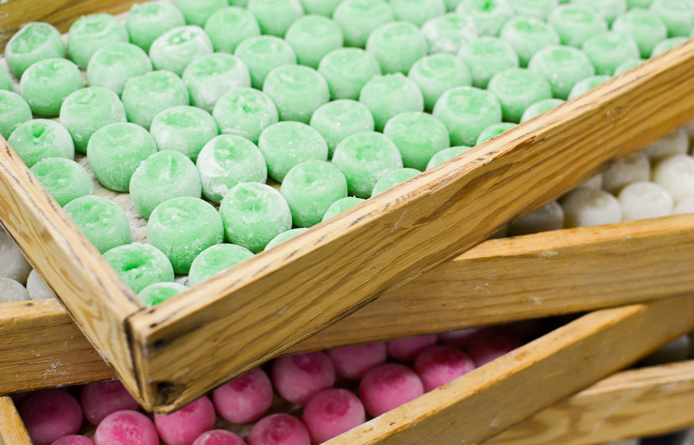 trays of green, white, and pink dango balls