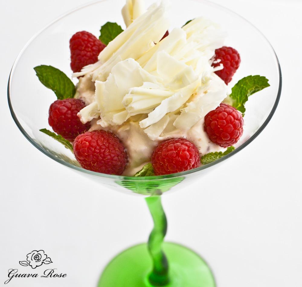 Cream cheese custard mousse w/raspberries and white chocolate truffle curls