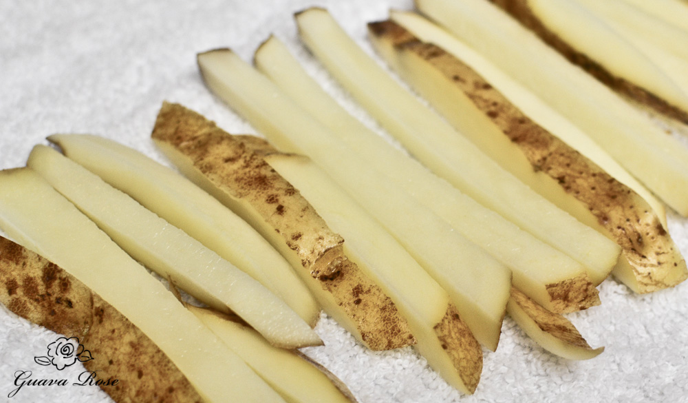 Raw French fry cut potatoes