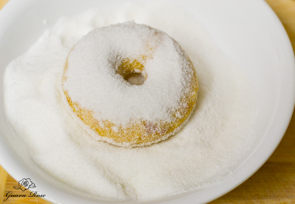 Baked donut in sugar bowl