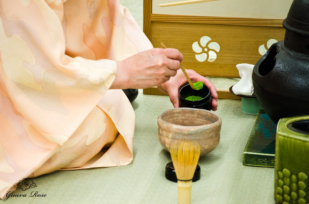 Scooping matcha with tea scoop into bowl during teaceremony