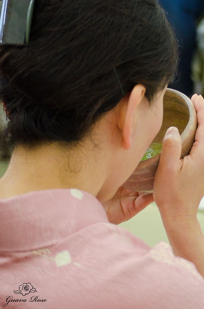 Mariko drinking the tea, back view
