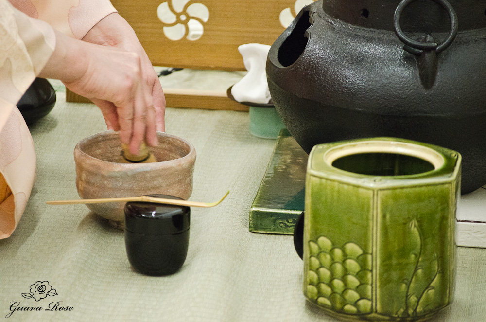 Whisking the tea during tea ceremony