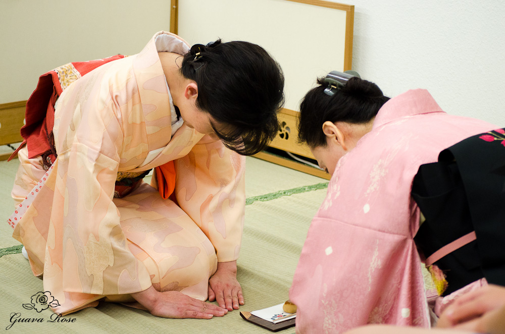Bowing after serving the manju