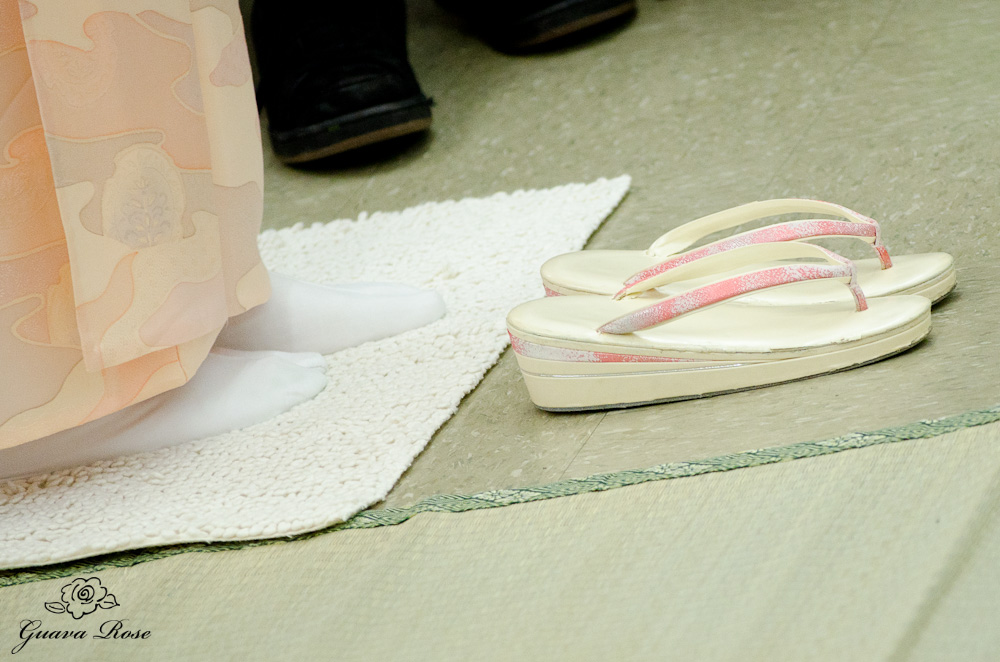 Removing slippers before stepping on tatami mat