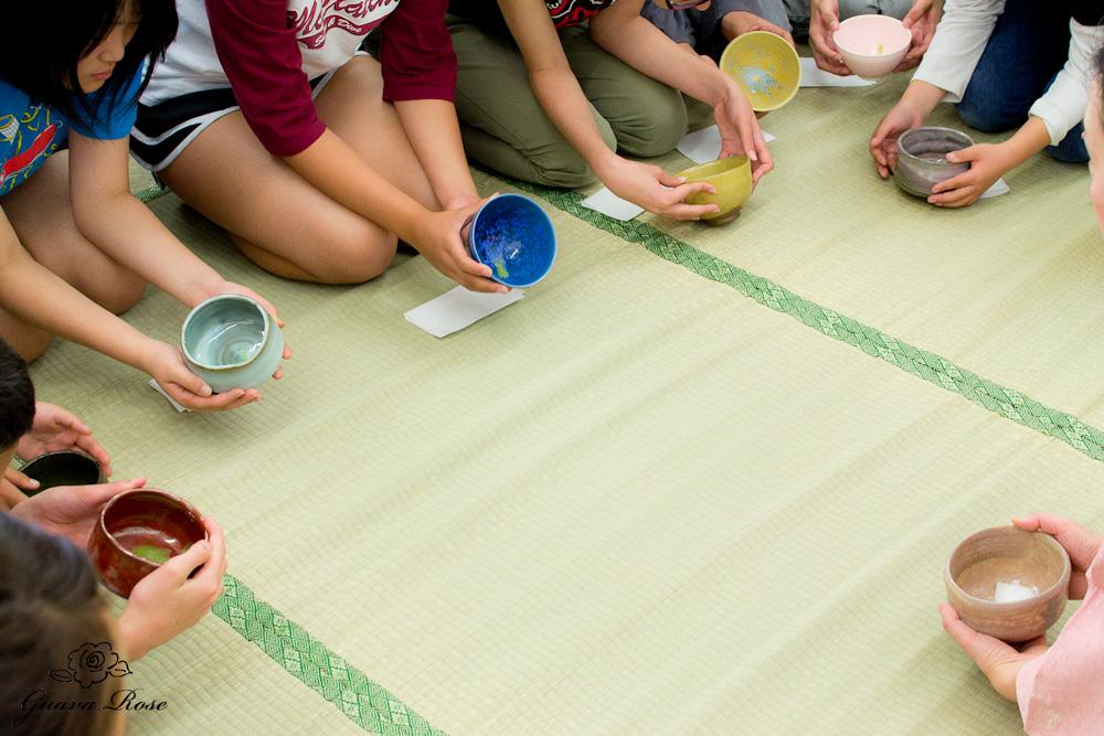 Students admiring the bowls
