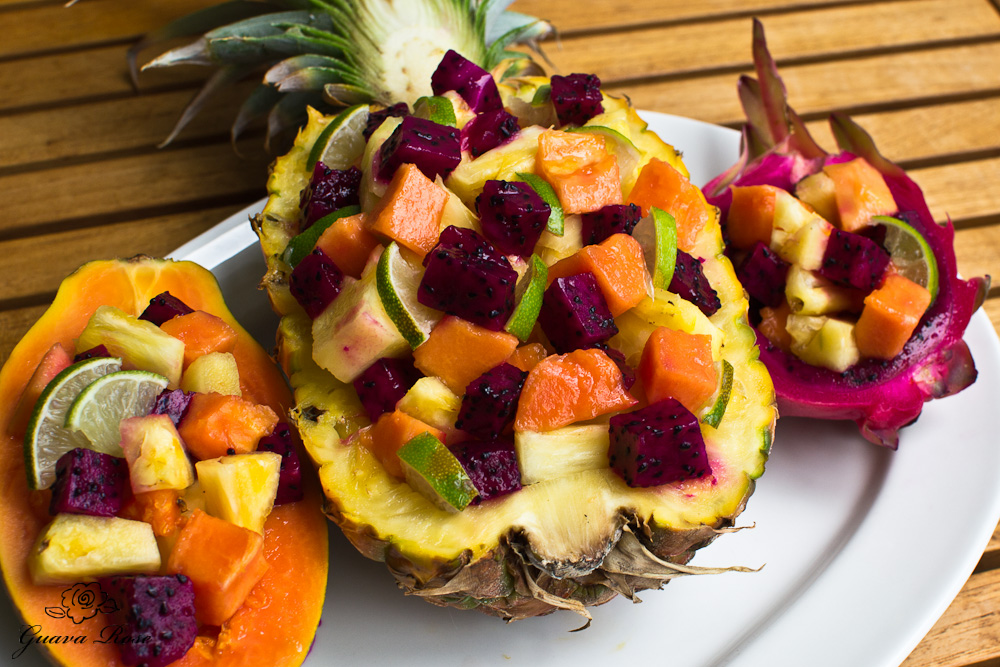 Fruit salad stuffed pineapple, papaya, dragonfruit