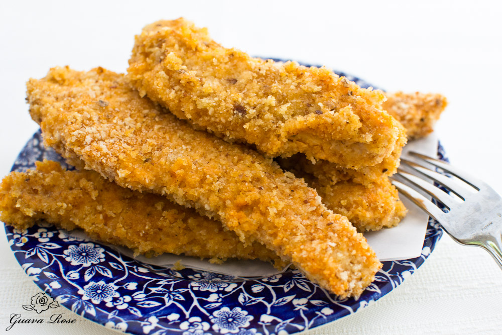 Spicy baked buttermilk chicken strips, fork on side