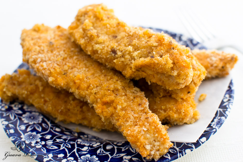 Spicy baked buttermilk Chicken strips, close up w/ fork in back