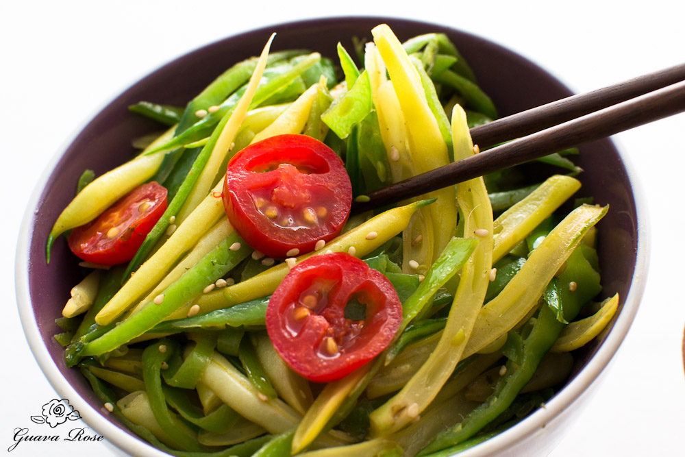 Stir fried snow peas and yellow string beans w/chopsticks