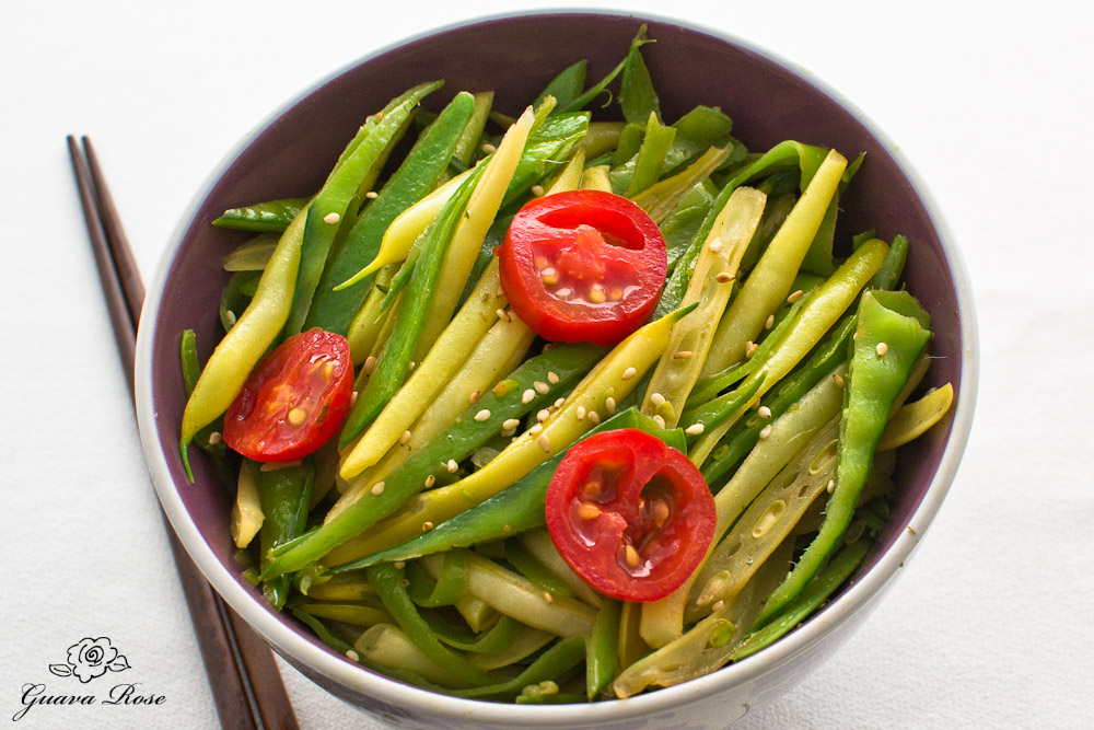 Stir fried snow peas and yellow string beans, top view