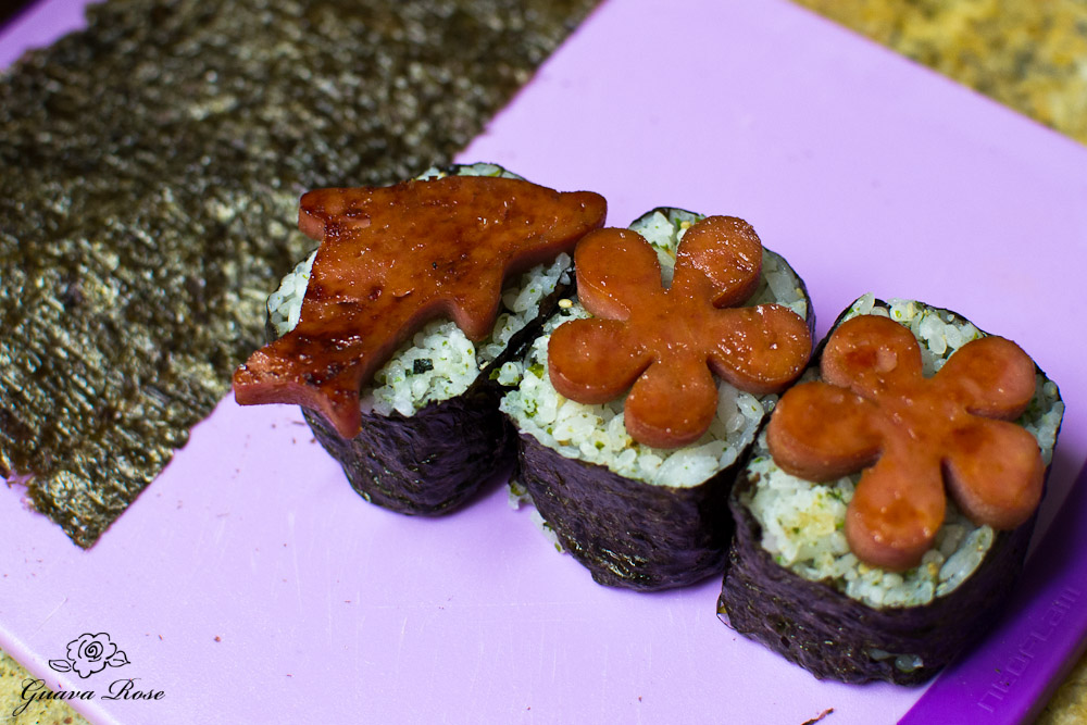 Spam cut outs on top of cut musubi