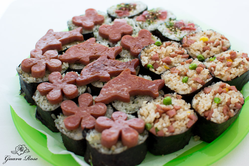 Spam cut out musubi, ume furikake musubi, spam fried rice musubi, top angled view close up