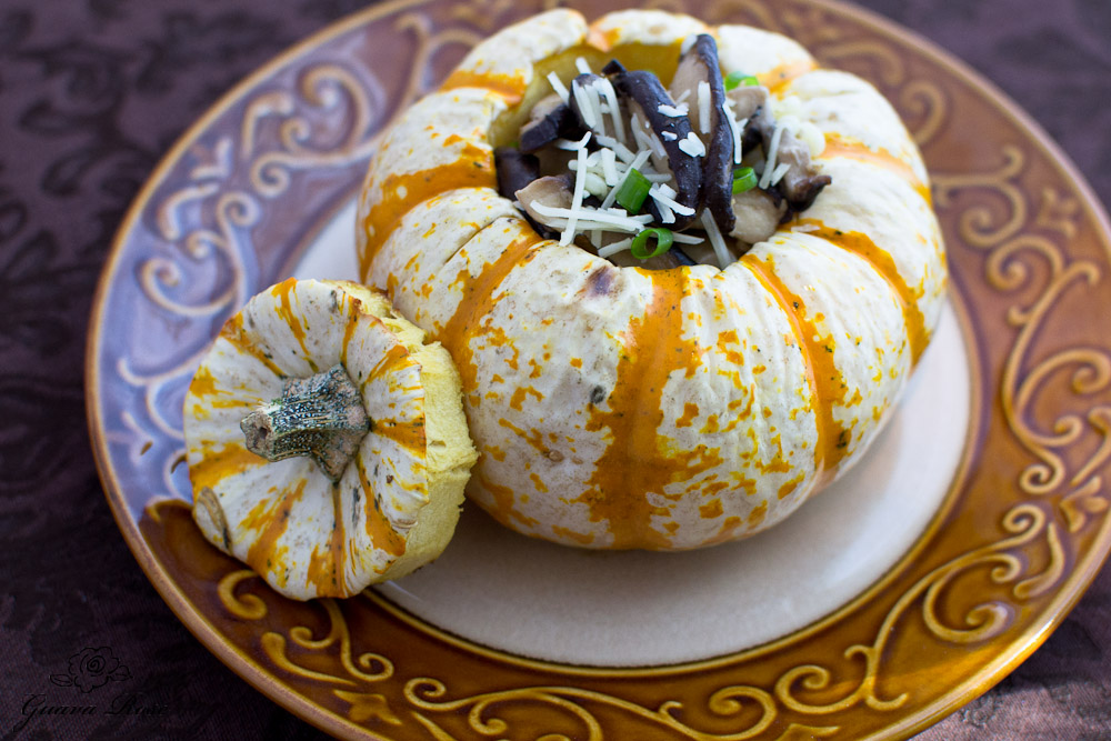 Tiger mini pumpkin filled with pearl couscous and sauteed mushrooms, close up