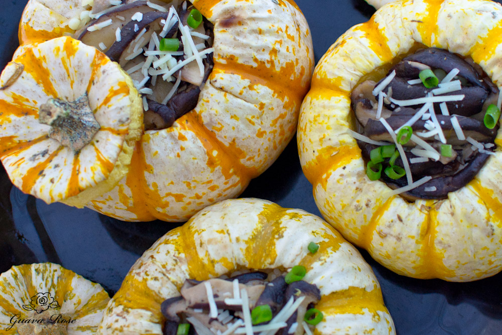 Tiger mini pumpkins filled with pearl couscous and sauteed mushrooms, close up tops