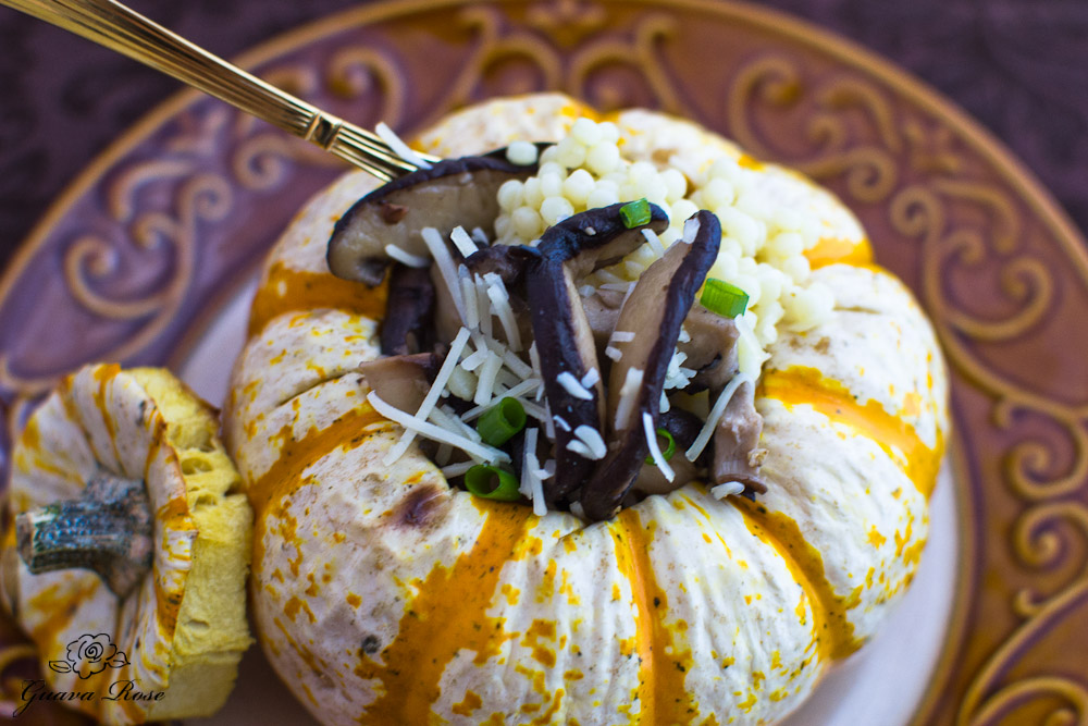 Spoonful in tiger mini pumpkin with pearl couscous and sauteed mushrooms