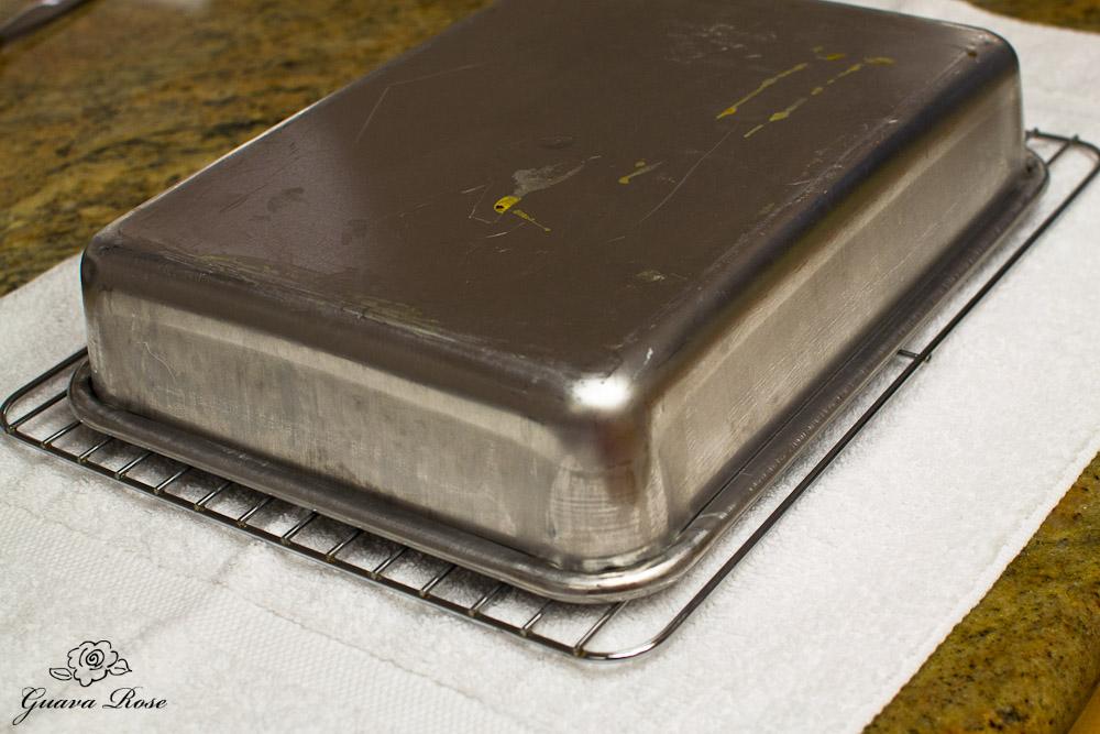 Chiffon cake turned over onto cooling rack