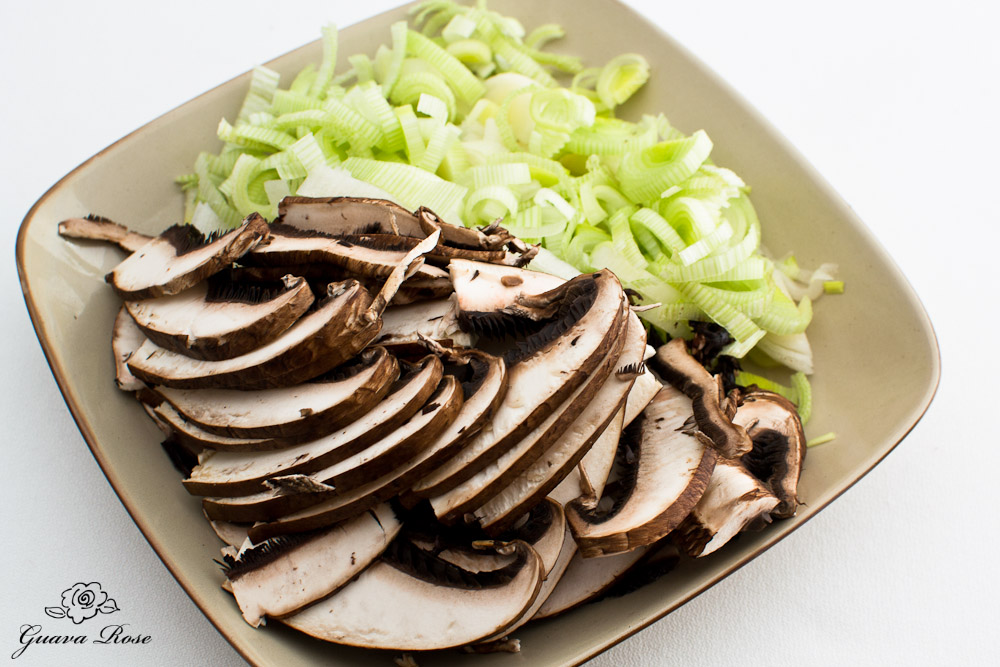 Sliced leeks and mushrooms on plate