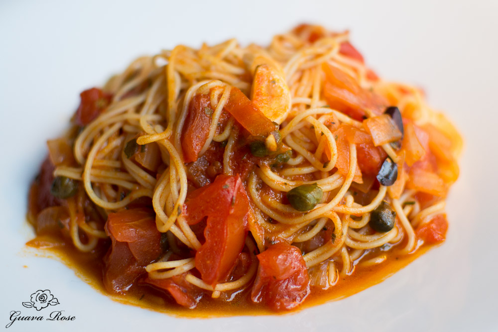Capellini Provencal: angel hair pasta tossed with tomatoes, garlic, herbs, capers and olives