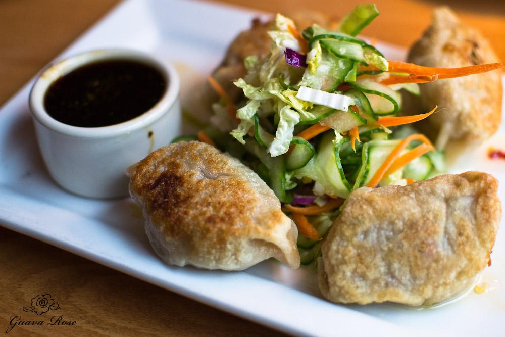 Pork-Kimchi Potstickers asian slaw, sweet chili drizzle, bulgogi dipping sauce
