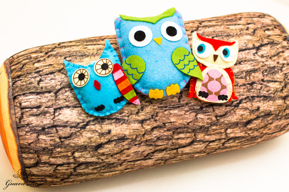 Felt owls on log pillow