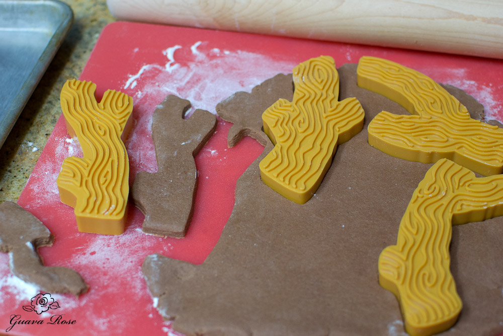 Cutting out tree branch cookie shapes