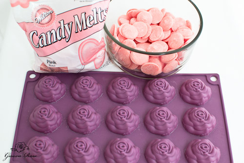 Pink candy melts and roses candy mold