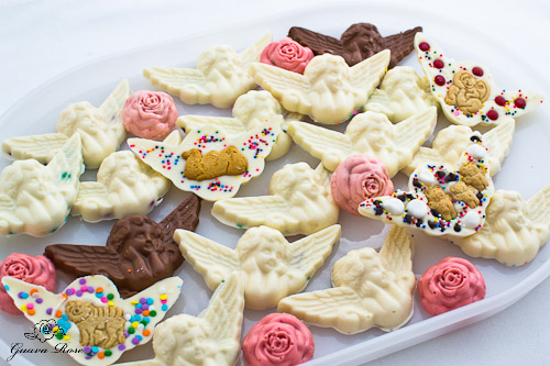 20 animal cracker angels (some backs showing) and 6 peppermint roses