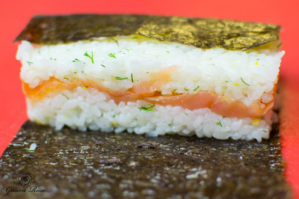 Wrapping smoked salmon musubi from spam musubi mold