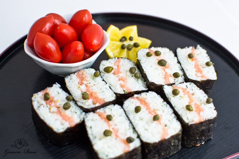 Cut smoked salmon musubi on tray