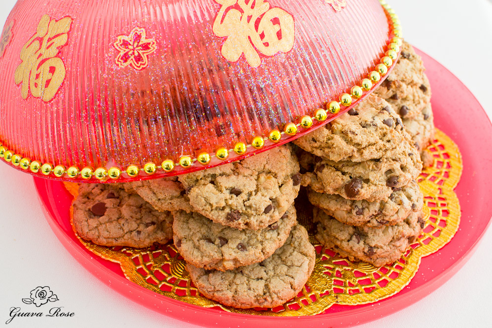 5 spice walnut date choc chip cookies under open Chinese candy box lid