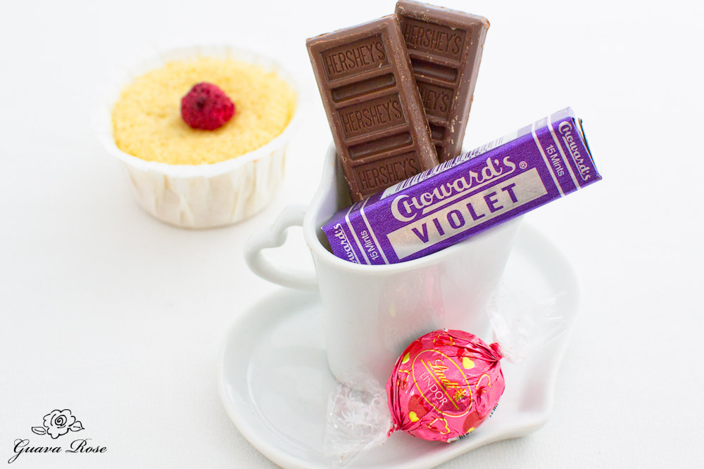 Teacup of candies with sponge cake