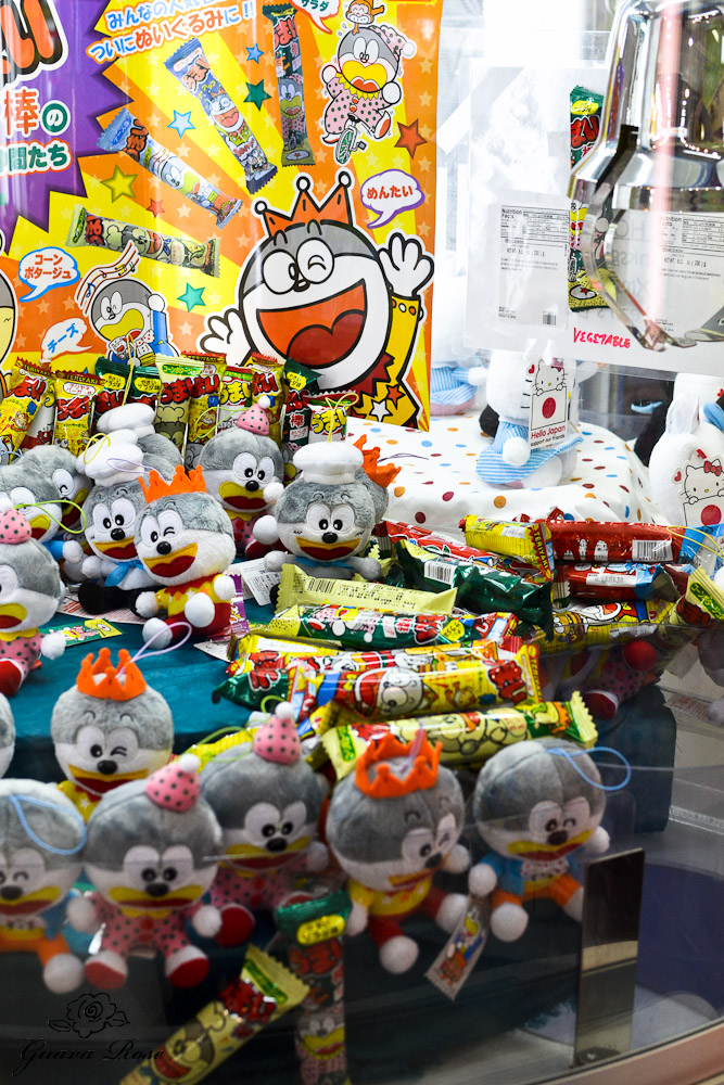 Crazy looking stuffed toys and candy prizes