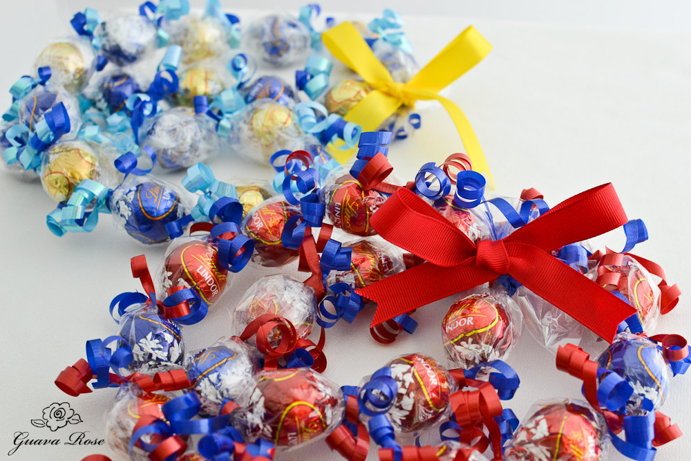 Red and Blue, and Blue and Gold Candy Kukui Nut Leis, spirals