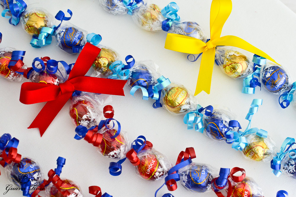 Red & Blue, and Blue & Gold Candy Kukui Nut Leis, diagonal